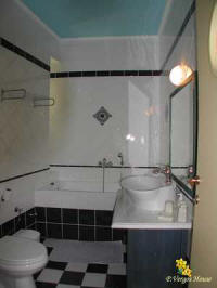 "photo he bathroom of n the second from the apartments of ""Vergos house"" accommodation in Parga."